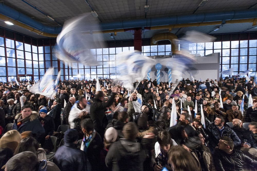 People wave flags, gesture and chant slogans in support of Silvio Berlusconi(***)s centre-right People of Freedom (PDL) party during its final rally before a ban on campaigning ahead of the vote. Italians cast their ballots on Sunday and Monday.