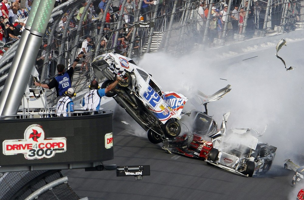 Driver Kyle Larson(***)s car (32) leaves the ground during a multi-car wreck on the final lap of the NASCAR