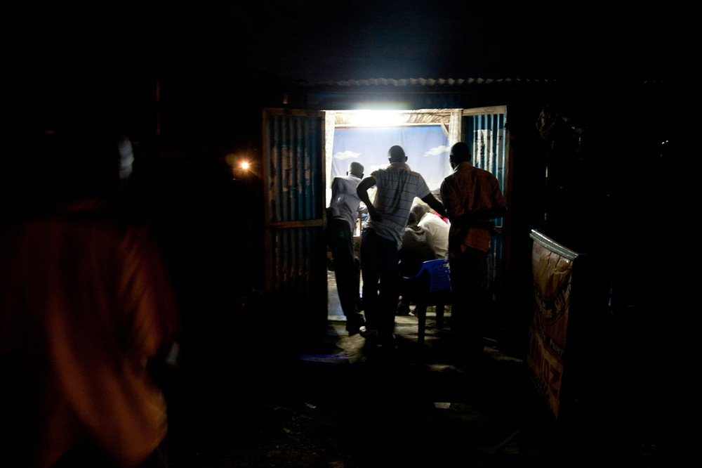 Kisumu residents watch the presidential debate in a barbershop. Kenya(***)s third largest city, the stronghold of candidate 