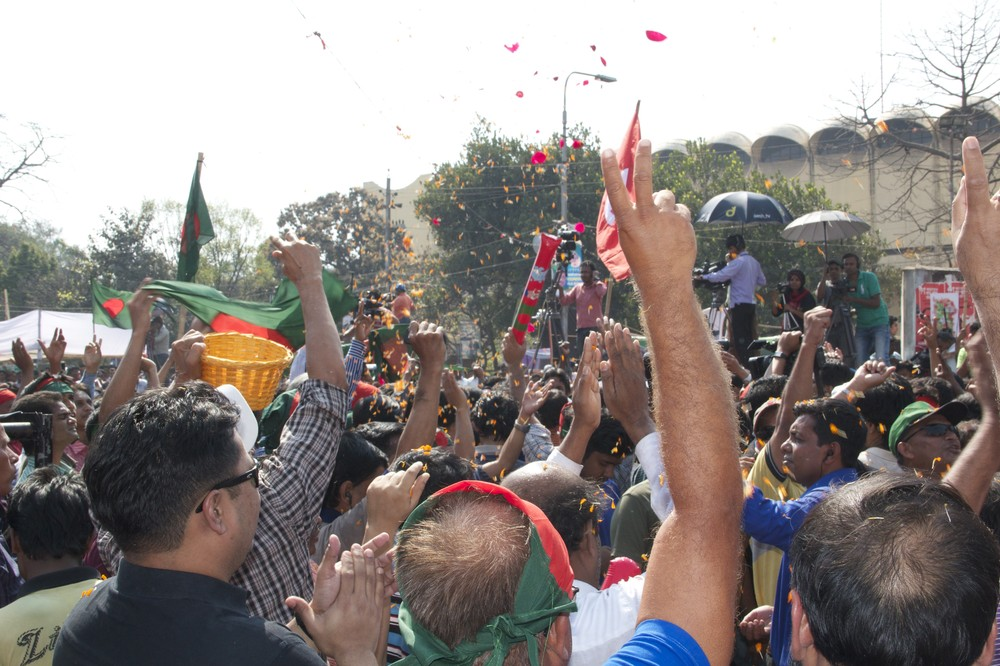 Flower petals are thrown in celebration of the death verdict for Delwar Hossain Sayedee, one of the top leaders of Jamaat-e-Islami, the country(***)s largest Islamic party.