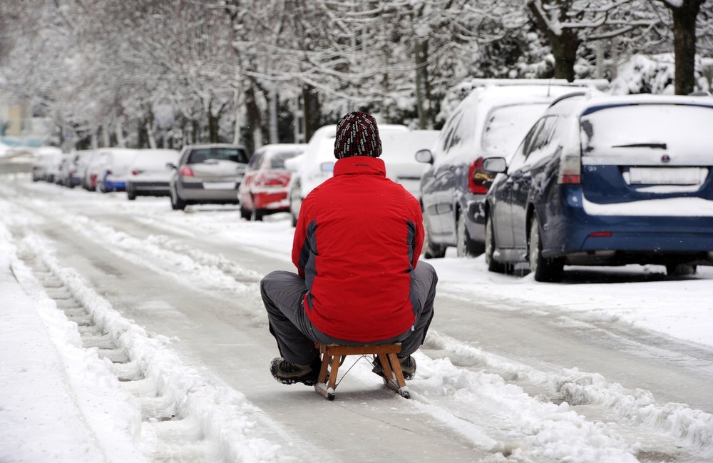 A man sleds down an icy road in Budapest, Hungary on March 15. Thousands of others unfortunately were stranded in their cars on Hungarian roads..