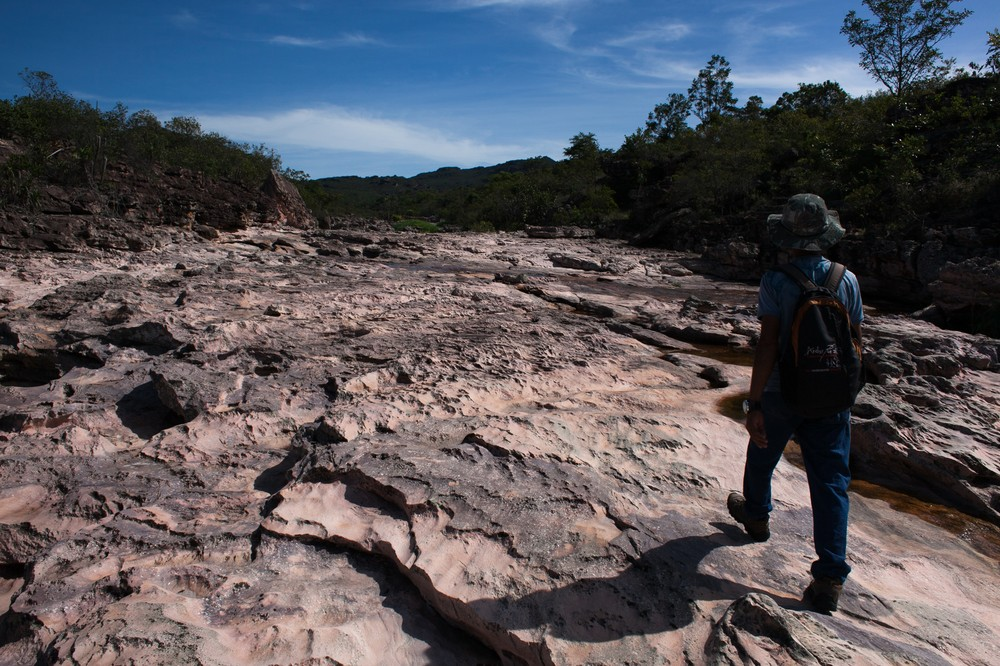 """Chiquinho,"" an ex-miner, walks through a dry river bed. ""I\(***)ve seen this river full from bank to bank at this same time of year, this month it was supposed to rain all week. The waterfalls are completely dry."""