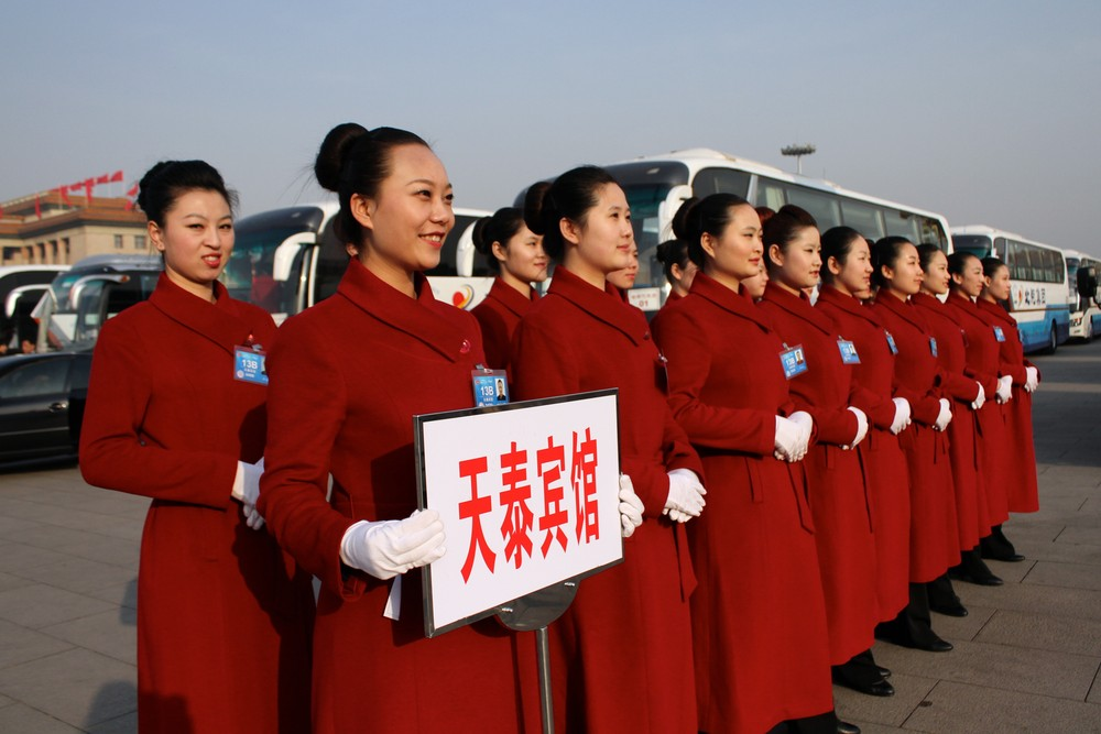 A group of hostesses pose in front of buses at Tiananmen Square in Beijing. The congress will complete China(***)s leadership transition that began with a Communist Party 