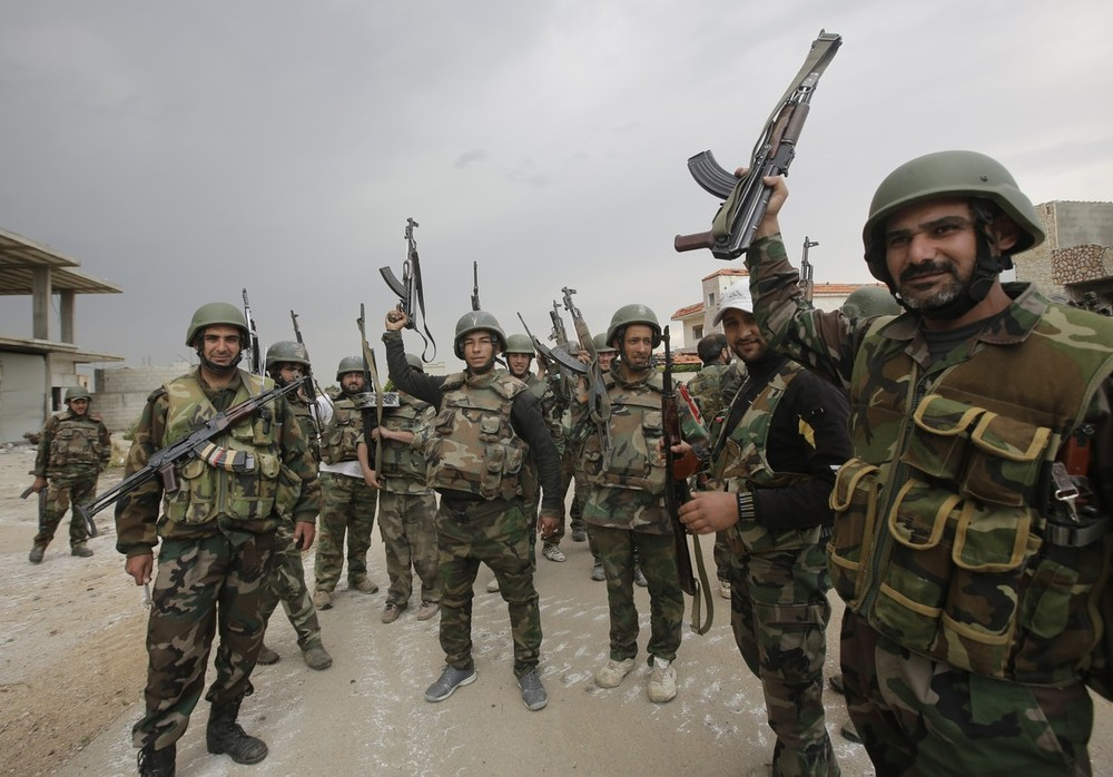 <p>Syrian troops celebrate as they take control of the village of Haydariyah, some seven kilometres outside the rebel-held city of Qusayr, on May 13. Syrian troops reportedly captured three villages in the strategic Qusayr area of Homs province.</p>