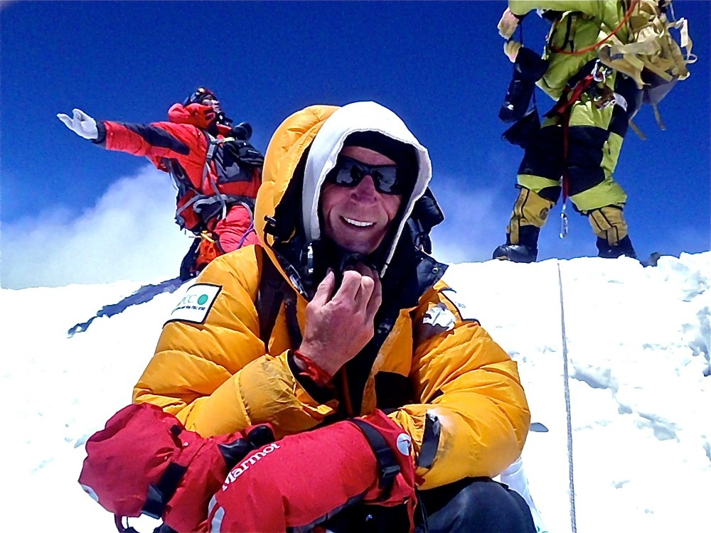 <p>On May 10, British climber, David Tait, became the first in the 2013 climbing season to summit Everest. His fifth time to the roof of the world, he celebrates along with a team of sherpas from Himex Expeditions. Tait climbs to raise funds for sexually abused children.</p>