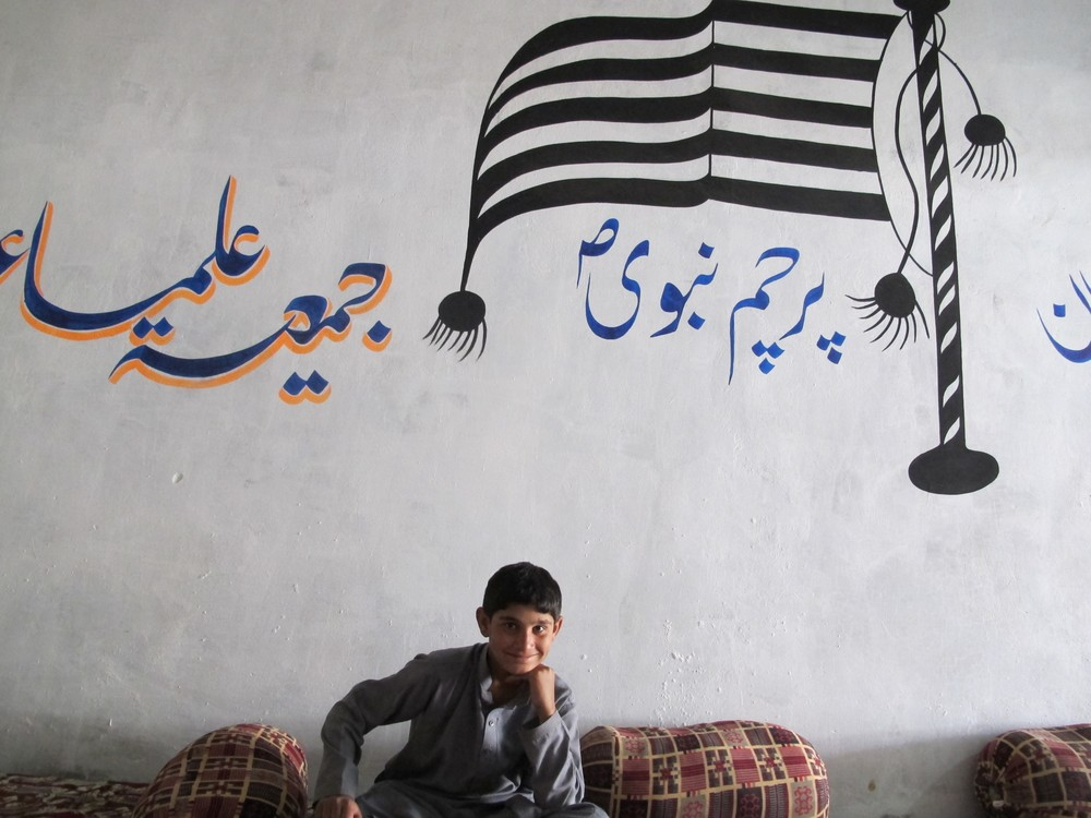 A young supporter of the Jamaat Ulema-e-Islami-Nazriati (JUI-N), a religious political party, sits in a campaign office in Quetta.