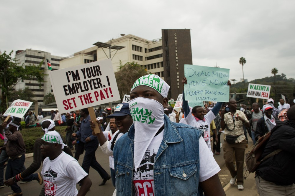 Demonstrators march through central Nairobi to the Kenyan parliament to protest pay-hikes voted through by politicians.