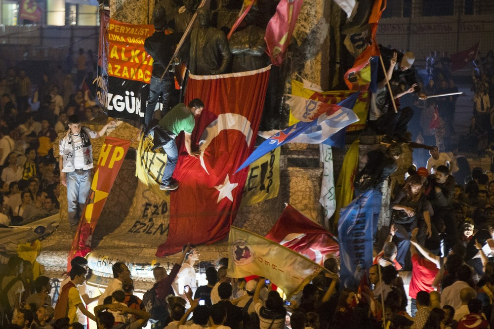 <p>Protests continue to flare across Turkey as Prime Minister Recep Tayyip Erdogan remains defiant over the the public(***)s anger about transforming Gezi Park into a shopping mall and perceived increasing state authoritarianism. Two protesters and one police officer have died thus far.</p>