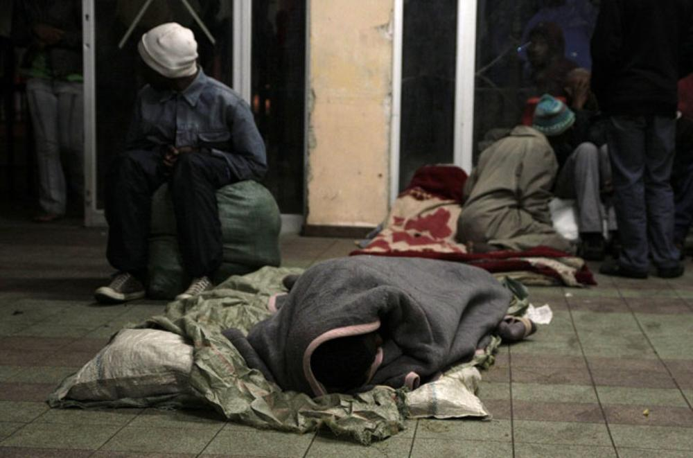 The Central Methodist Church is a haven for displaced Zimbabweans living in central Johannesburg.People make their beds in the entrance of the church [Eugene Arries/Al Jazeera]