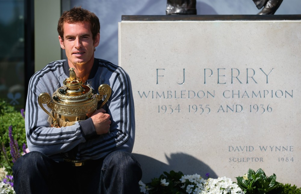 Andy Murray ended Britain\(***)s long wait for a male Wimbledon champion with a straight-sets victory over Novak Djokovic. Here he is pictured alongside Fred Perry\(***)s statue, the last man to win the title in 1936.