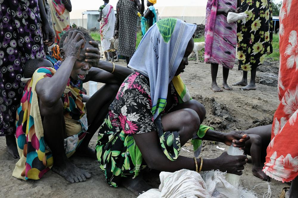 Murle women wait for food in the small town of Pibor, in South Sudan\(***)s Jonglei state.