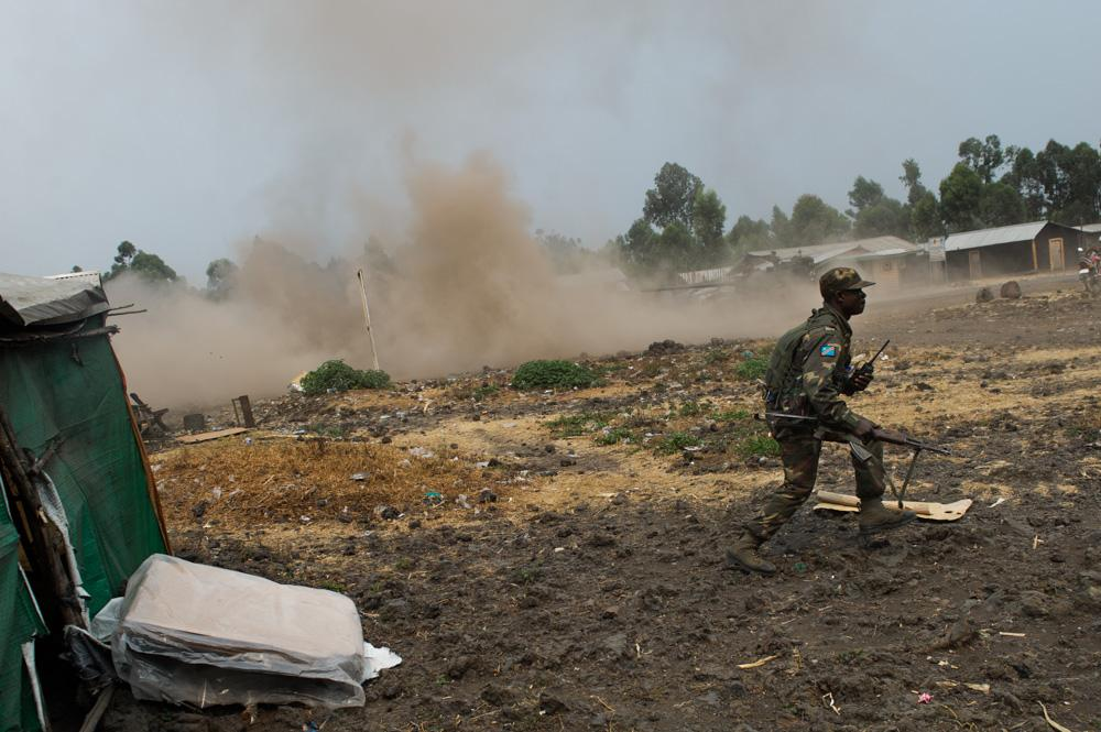 <p>A government army soldier reacts to shelling in Kanyarucinya, just north of Goma. The army pushed back M23 rebels.</p>