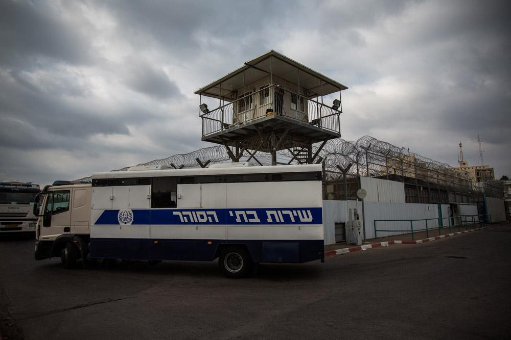 <p>A police truck drives out of of Ayalon prison on August 13, 2013 in the city of Ramla, hours before Israel released 26 Palestinian prisoners.</p>