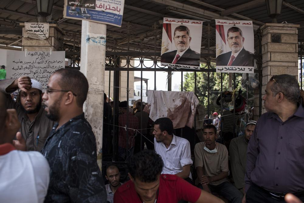 <p>Family members identify the bodies of supporters of deposed Egyptian President Mohammed Morsi, hundreds of whom were killed during a violent crackdown in Cairo by Egyptian security forces on Wednesday.</p>