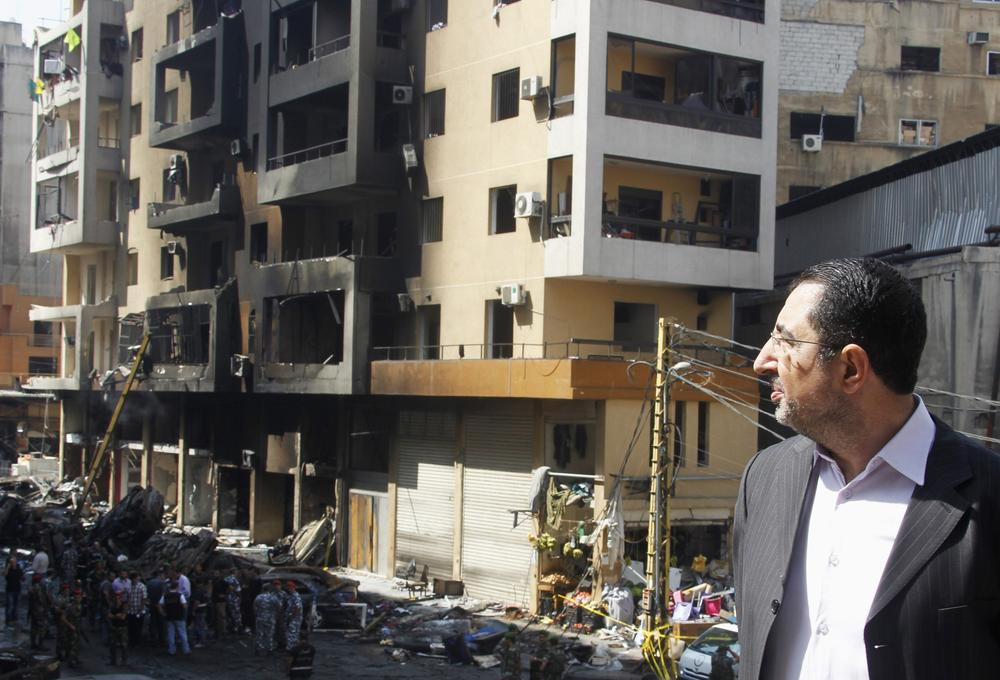 Lebanon\(***)s Hezbollah MP Hussein Hajj Hassan inspected the site of the car bomb that occurred in Beirut\(***)s southern suburbs on August 16, 2013 [Reuters]