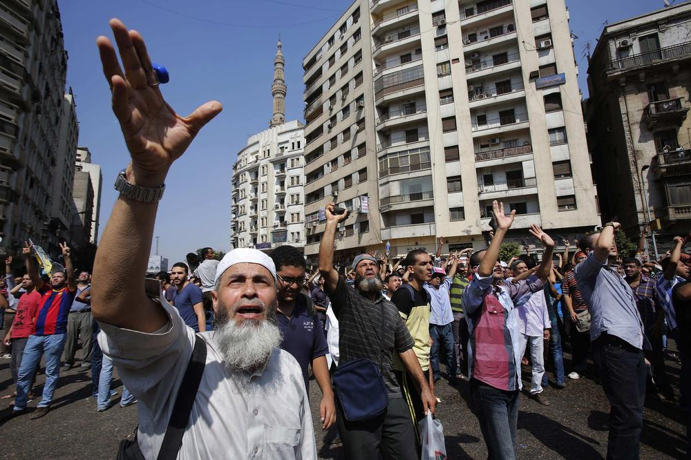 Supporters of Morsi shout slogans during a protest outside Al-Fath Mosque in Ramses Square.