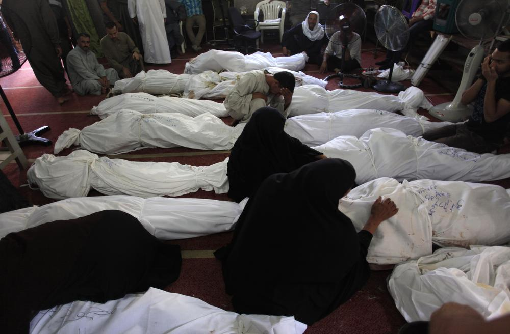 <p>On August 14, hundreds of demonstrators were killed and thousands injured after security forces evicted sit-in camps protesting the army(***)s July coup against former President Mohamed Morsi. Above, Egyptians mourn over the bodies of their relatives.</p>