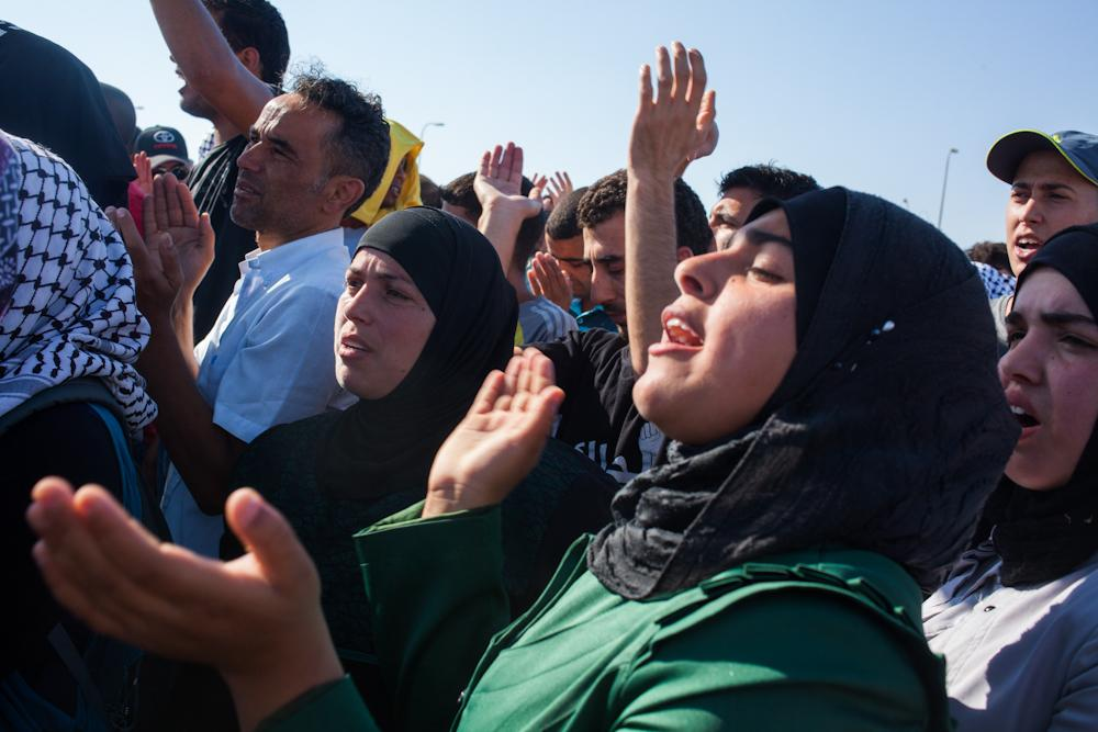 "Protesters gathered at a main road junction in Israel\(***)s Negev desert - to chant and sing in opposition to the ""Prawer Plan"", which would see thousands of Bedouin residents of the Negev removed from their homes and forced into townships."