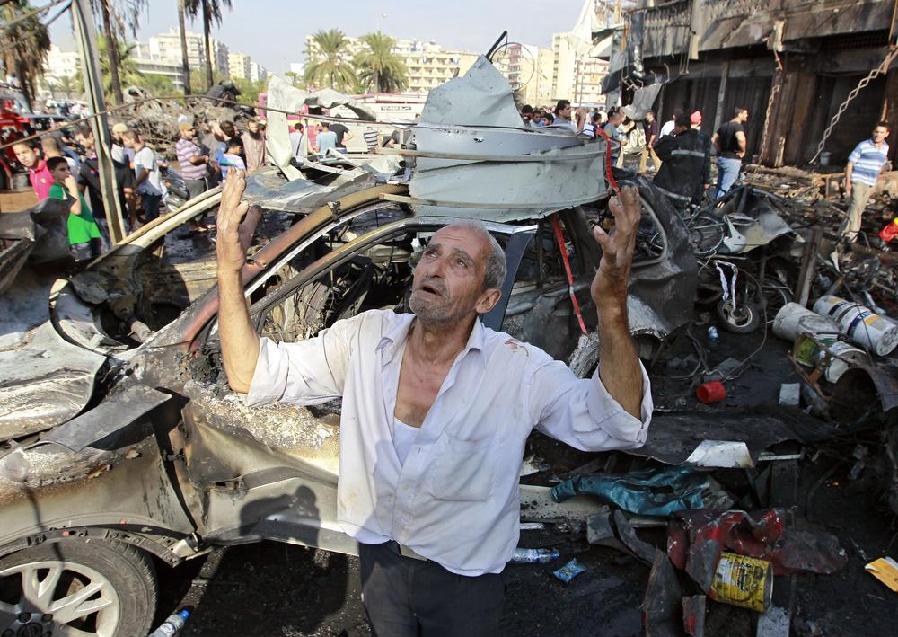 <p>Two car bombs exploded in the northern Lebanese city of Tripoli, leaving at least 47 people killed and another 500 wounded (AP Photo/Bilal Hussein)</p>