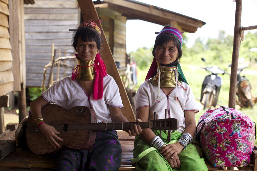 Mouchan and Marie recently returned to the their village from the ancient city of Bagan, where they entertained tourists singing traditional Kayan songs. [Andrey Kovalenko/Al Jazeera]