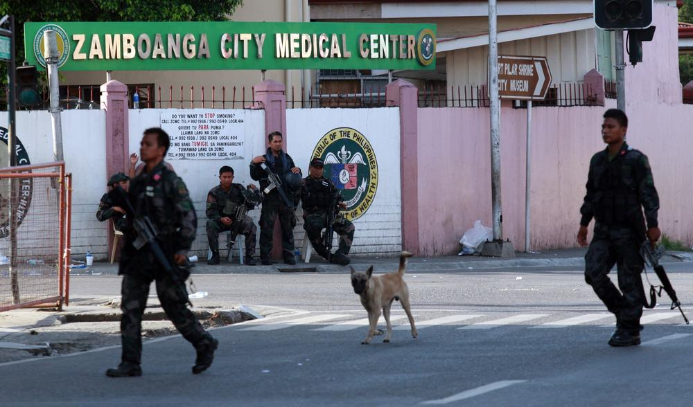 Soldiers patrol the main streets of the southern Philippine city of  Zamboanga.