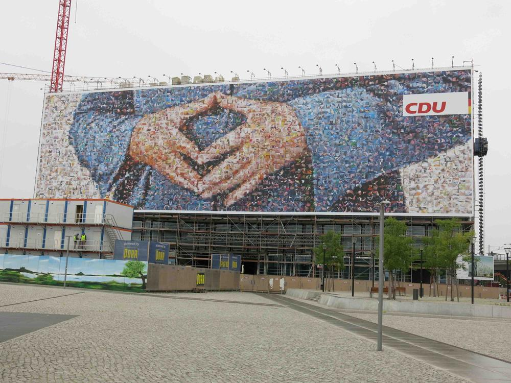 "Said to be the largest political advertisement ever in Germany, the chancellor's hands form her trademark ""Merkel rhombus"" next to Berlin's main train station."