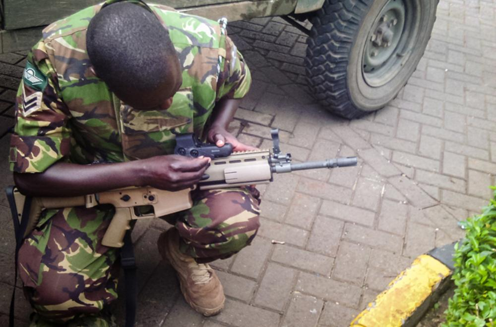 <p>A soldier prepares his kit before an assault on Al Shabab militants by the Kenyan military. The attackers from the Somalia-based group had barricaded themselves in a shopping centre and were suspected to have explosives.</p>