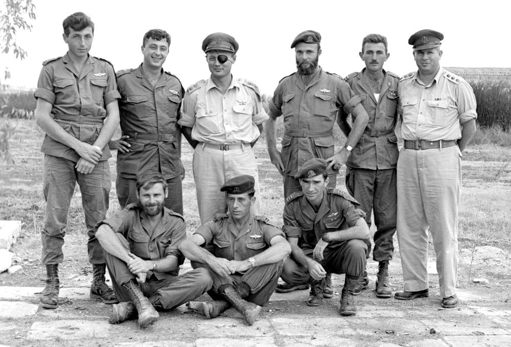 <p>Ariel Sharon (2nd L) stands with Moshe Dayan (3rd L) and other military commanders in this picture taken October 28, 1955 and released by Israel(***)s Defence Ministry. Sharon created Israel(***)s modern &quot;military norms&quot; through his founding of a secretive &quot;retribution squad&quot;, Unit 101, that operated through the 1950s and 1960s.</p>
