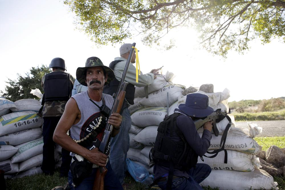 Many members of the militias are armed with rifles and semi-automatic weapons.