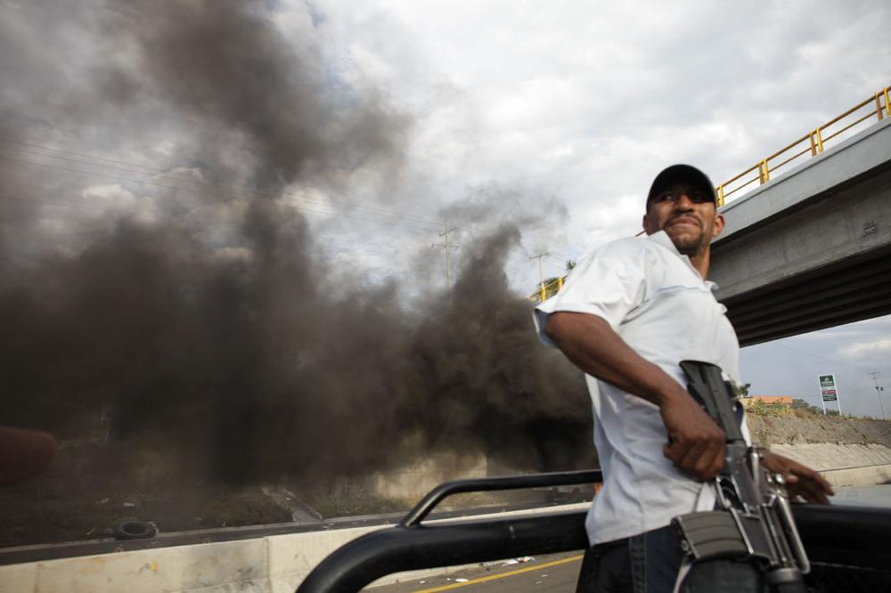 On January 11, as the militia advanced on Antunez, smoke from a roadblock set up by the cartel filled the air.