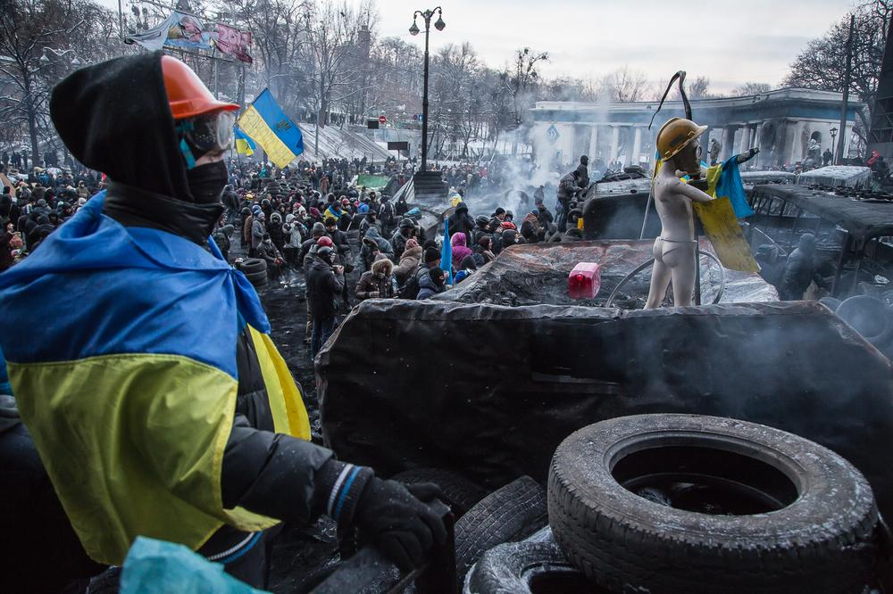 Following deadly clashes, security forces and protesters in Kiev are observing a temporary truce.
