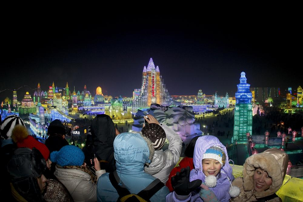 Tourists from all over the world braved the -29C in Harbin as the ice festival opened on Sunday.