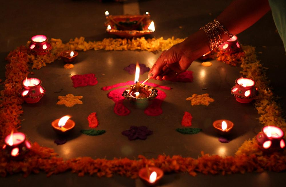 In pictures reinventing diwali traditions india al for Simple diwali home decorations