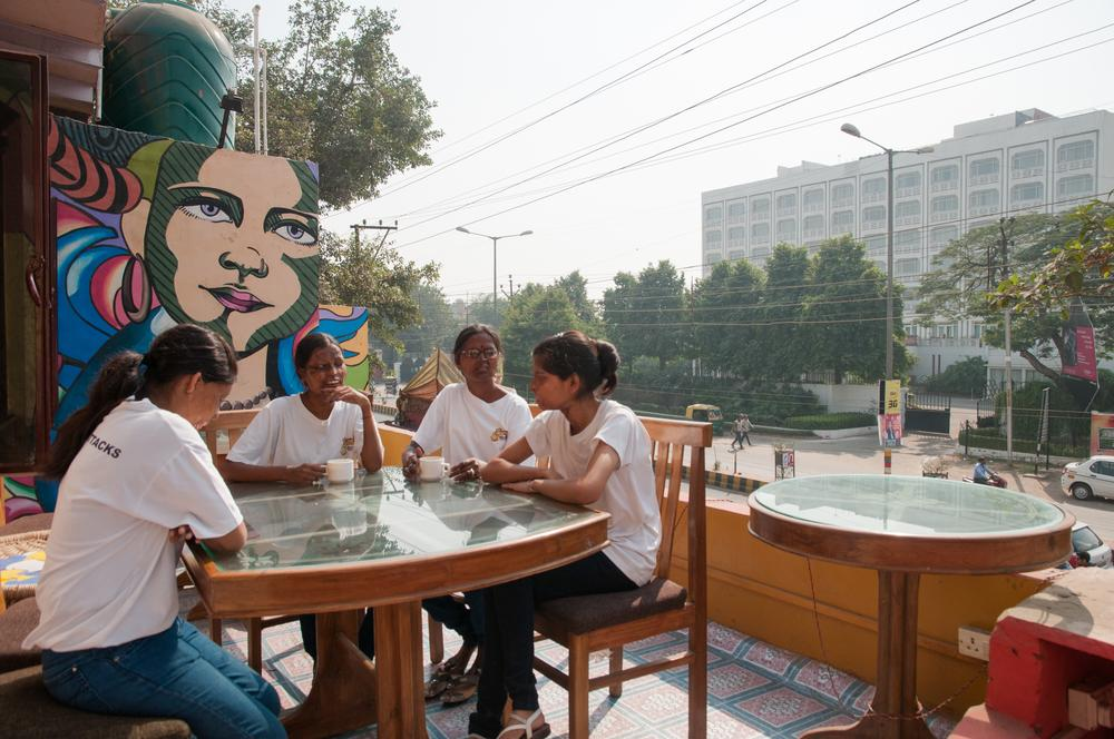 Staff members take a moment before starting their day at the cafe. According to an ACID Survivors Foundation India [ASFI] report, there have been 518 recorded cases of acid attacks from January 2010 to July 2014. [Vaibhav Bhardwaj/Al Jazeera]
