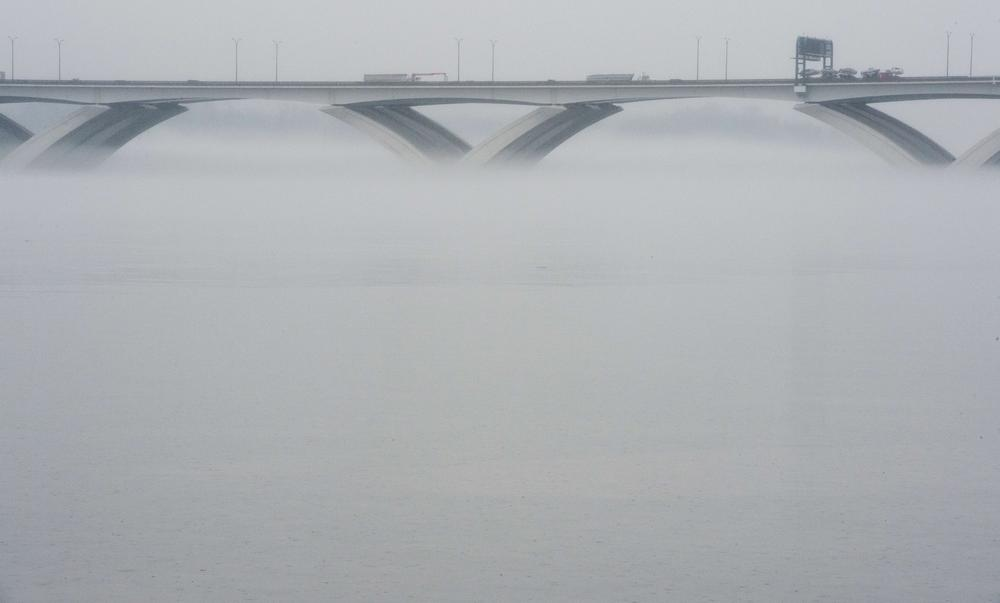 Fog is, in effect, low cloud. Like all clouds it has a base (the ground) and a top (here just below the top of the Wilson Bridge over the Potomac River in Washinton DC).