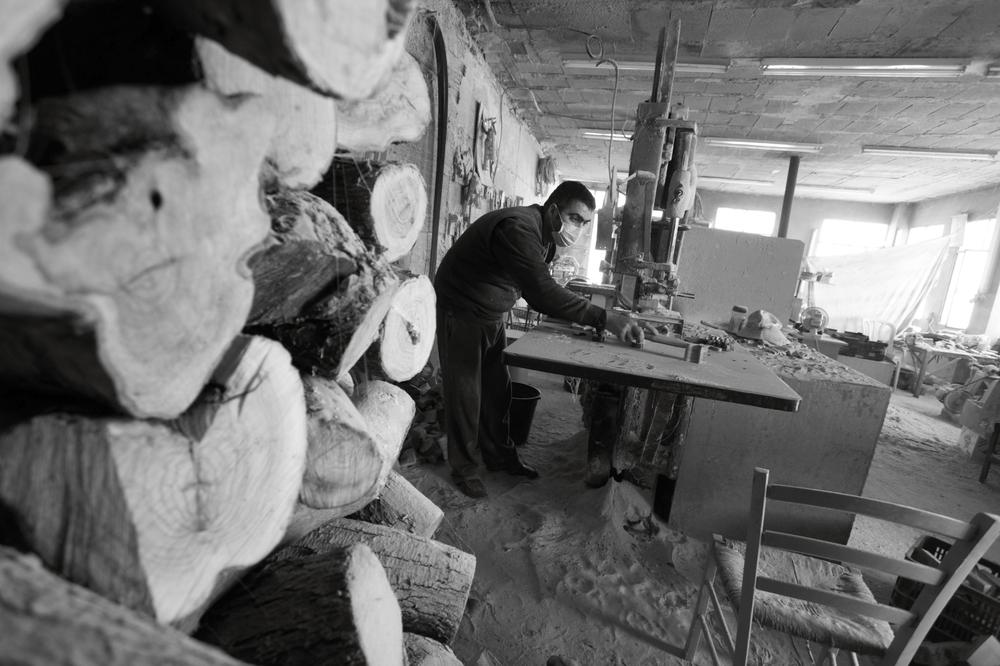 In a small workshop in Beit Jala, Jeries Lolas manages the family(***)s olive wood carving business. Lolas(***) grandfather founded the business more than seven decades ago, although the existing workshop was established more recently.