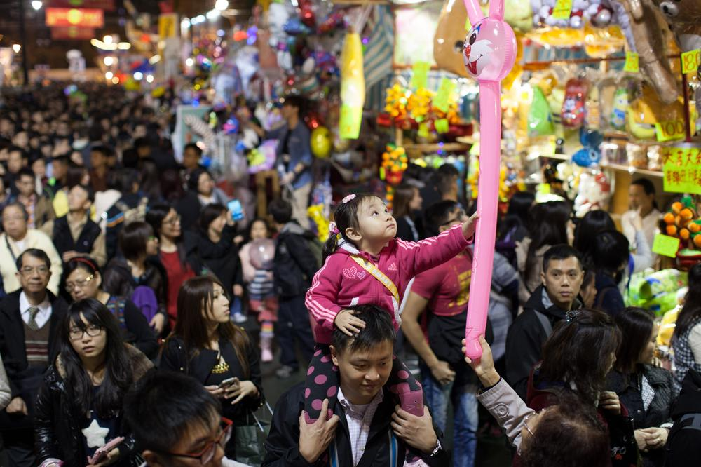 Tens of thousands of people gathered at Victoria Park for the Lunar New Year Fair to enjoy the festive spirit. [Andrey Kovalenko/Al Jazeera]