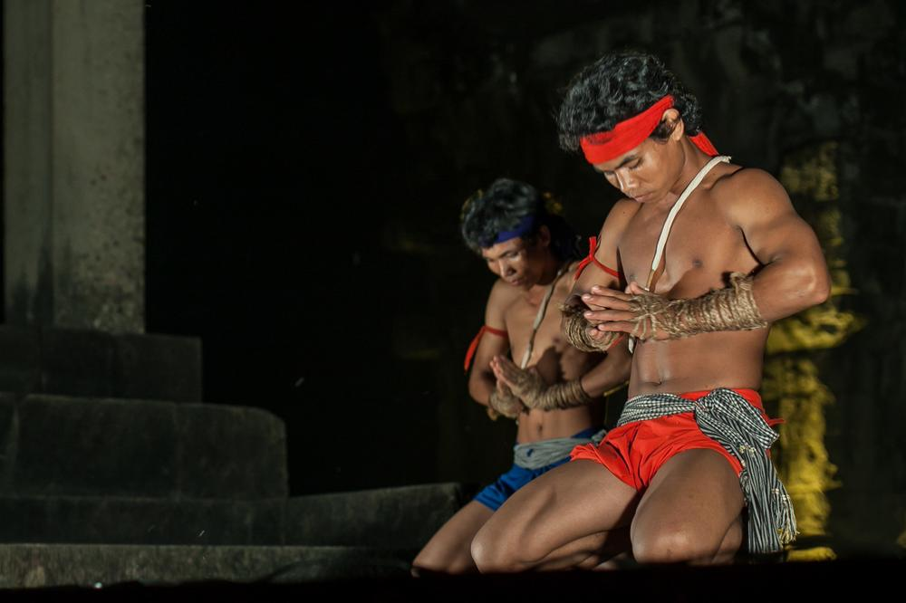 <p>Traditional fighters perform Kun Krou rituals prior to combat at a private night fight in the Angkor temple of Thomeanon near Siem Reap. Bokator and Kun Khmer fighters are hired for private functions during the dinners that many hotels and travel agencies organise for their clients in the Angkor.</p>