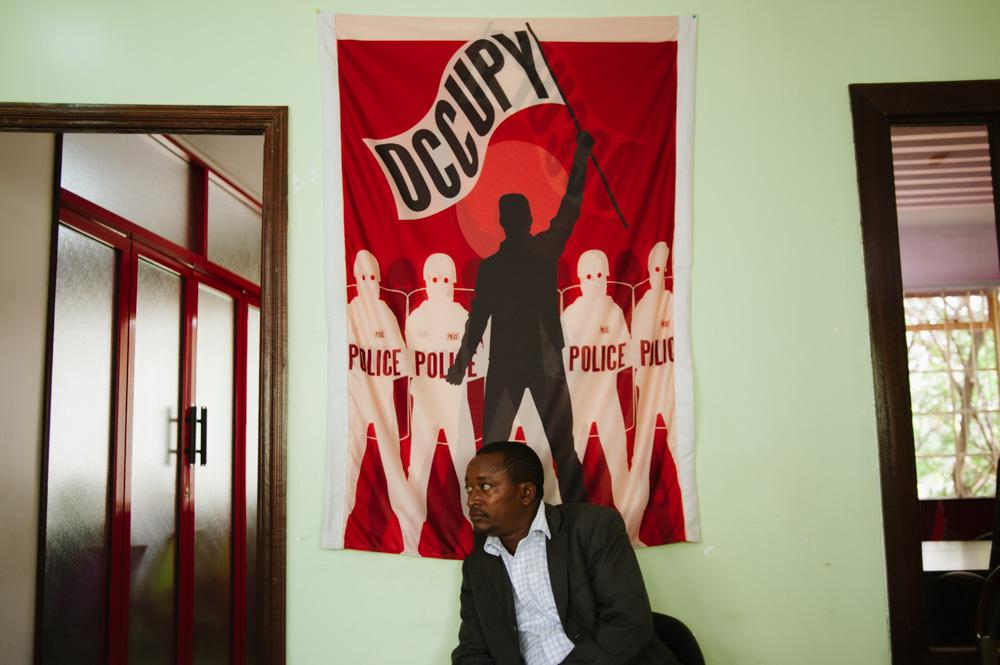 <p>A Kenyan man sits in an arts centre in Nairobi, used as a rallying point for the protest, under the banner of the global &quot;Occupy&quot; movement.</p>