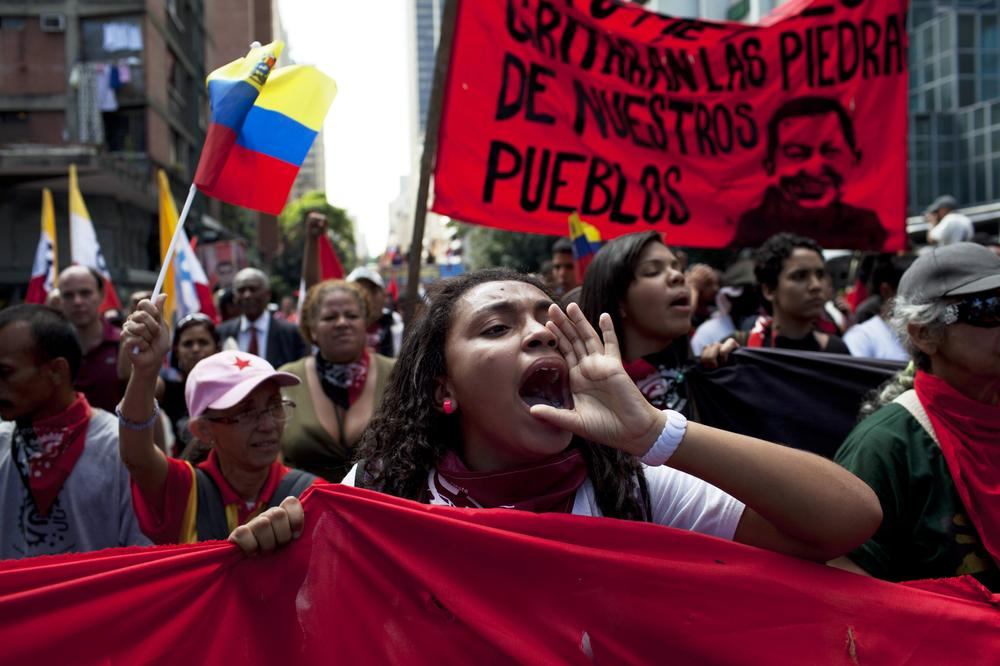 <p>Members of a pro government &quot;colectivo&quot;, march in downtown Caracas, Venezuela on Thursday.</p>