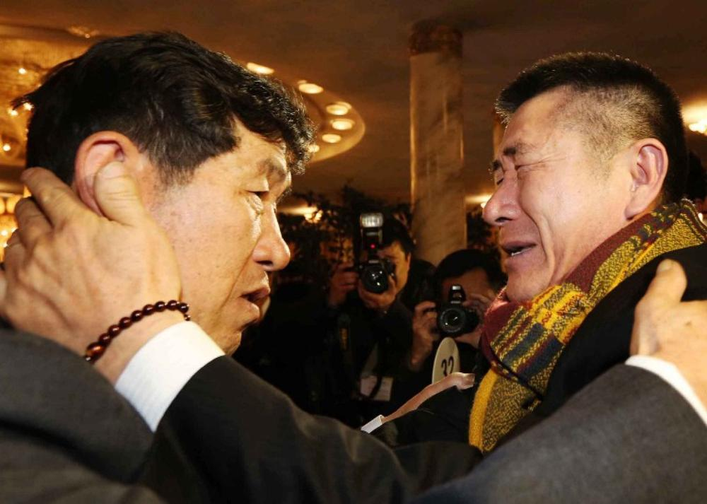 Park Yang-Kon (R) of South Korea bids farewell to his brother Park Yang-Soo of North Korea, as he prepares to depart the North Korean Mount Kumgang resort area on the third and final day of the first group of family reunions between North and South Korea, on Saturday February 22.
