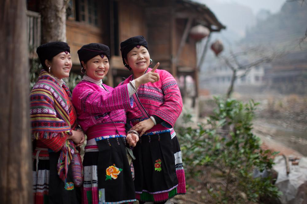 <p>Yao women often wear traditional clothes of bright red colours, decorated with embroidery, along with silver earrings and necklaces.</p>
