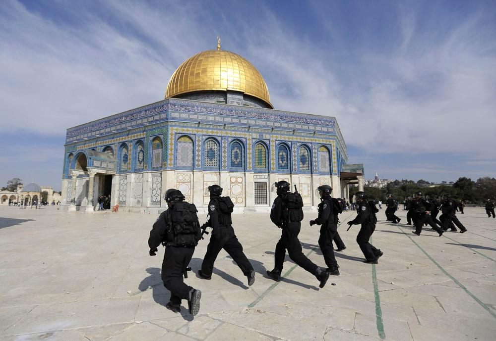 <p>Israeli police officers raided the al-Aqsa mosque compound on Friday, in clashes that left at least one person severely injured. An Israeli spokesperson said security personnel had been responding to stones thrown at them.</p>