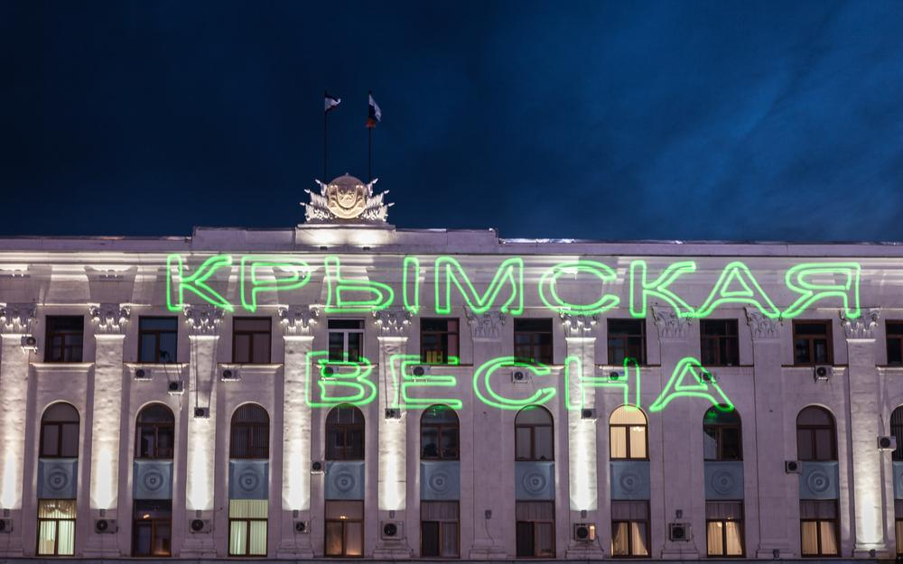 <p>At night, the words (***)Crimean Spring(***) are projected onto a government building in Simferopol(***)s Lenin Square prior to a victory party amid exit polls suggesting at least 90 percent voted in favour of joining Russia.</p>