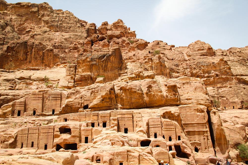 <p>Traditional rock-cut Nabatean tombs can be seen along the lower part of the ancient city of Petra.</p>