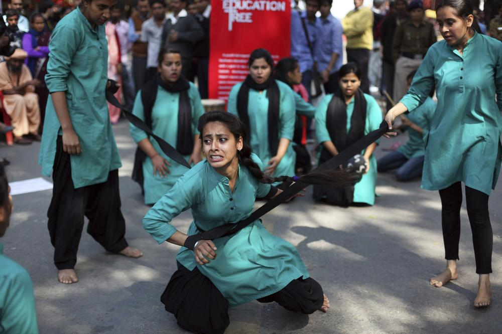 Indian college girls performed a street play on violence against women in New Delhi.