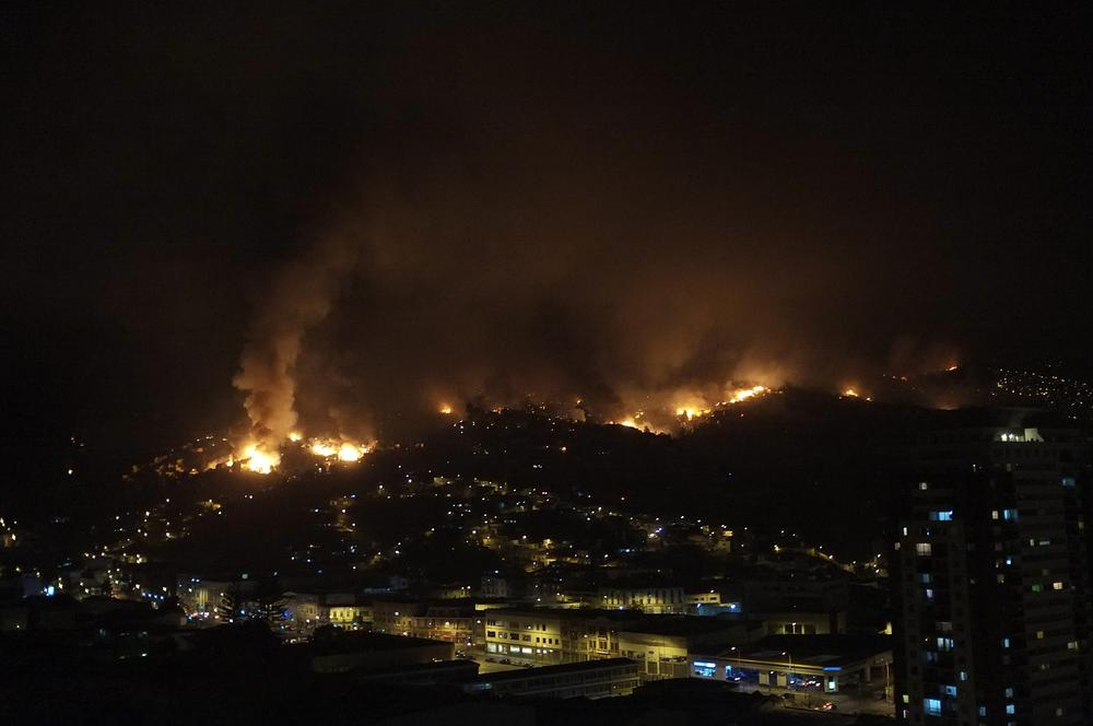 <p>A view of houses affected by a fire on April 12 in Valparaiso, Chile. The wildfire has destroyed approximately 500 houses and forced the evacuation of more than 2,000 people.</p>