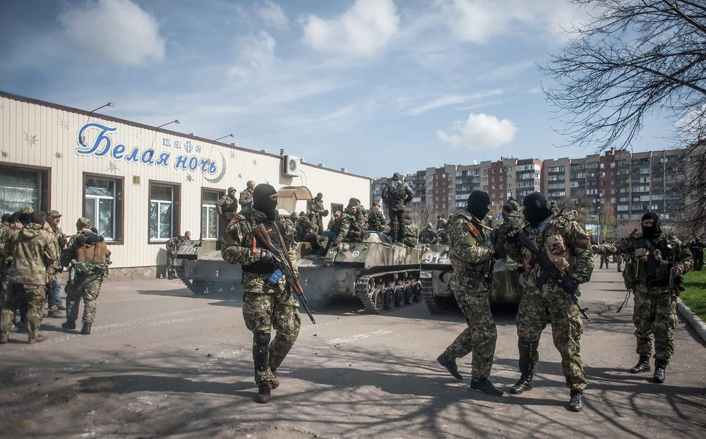 <p>Armed pro-Russian protesters stand near combat vehicles in Slovyansk, a city in eastern Ukraine, on April 16. Separatist fighters have refused to disarm and vacate government buildings despite a negotiated agreement telling them to do so.</p>