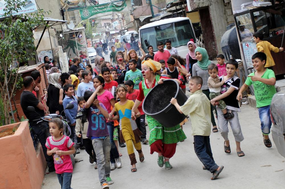 The clowns paraded through the streets of the Shatila refugee camp with children and other camp residents.