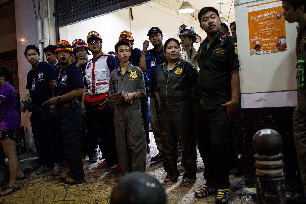 <p>Ruamkatanyu Foundation<span style=&quot;font-size: 14px;&quot;> </span>volunteers and other medical and rescue teams wait for an emergency call at their meeting point while revellers enjoy the Thai New Year, Songkran. In addition to the personnel from the foundation, the base has firemen, paramedics and rescue service teams. All of them are volunteers.</p>